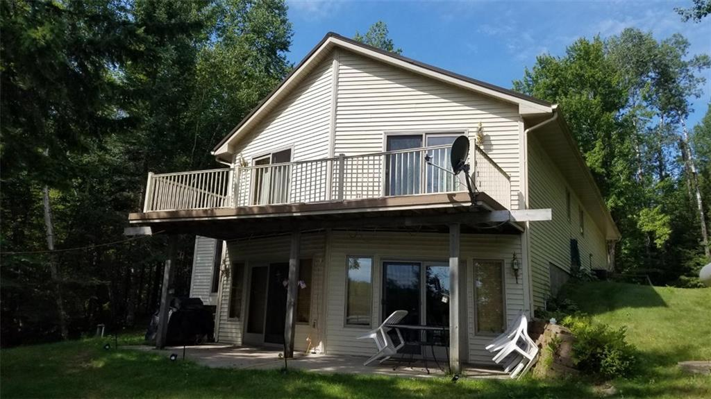 Privacy, nature is what you'll have here on the Radison Flowage. Eagles nests and loons out in your own front yard! The Toscoba Trail is just 1/5th of a mile away from lake for snowmobiling and 4-wheeling. Very quality built 4 bed 2 bath home is ready for you to enjoy. Furnishings stay. 2.24 acre hunting lot is included. Newer hot tub and furnace. Dock and pontoon lift included. Come and enjoy NW WI!