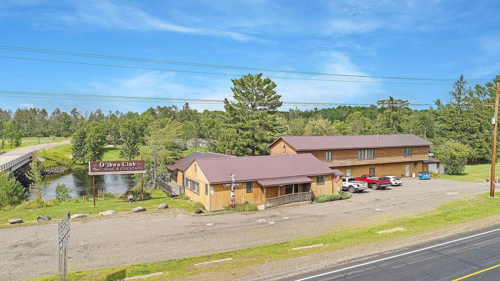 Love the Chippewa River? You will be enticed by the views & the many possibilities with this home. With attached garage and also a large attached building that used to be a popular restaurant/bar with tons of room. (Liquor license still available).  Live & work in a beautiful location about half hour to;Hayward, Ladysmith or Park Falls. The Tuscobia ATV/SNOW trail is right across the street! Watch the wildlife right from your riverside deck and be on the Chippewa Flowage in about 10 min! Ojibwa is a quiet & safe town- and Winter, which is 5 minutes away..has a k-12 School & the community provides most the necessities one would need! So many opportunities here-your head will spin!  Motivated Sellers!
