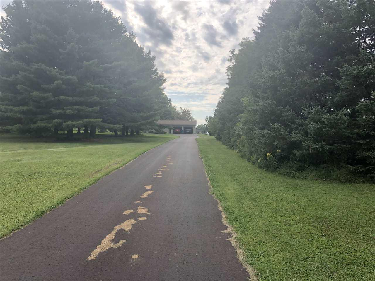 3 bedroom county home on 5.236 acres, 30x80 horse stable with concrete floors, power, water and matted stalls, 30x80 1/2 hay loft building, 24x48 concrete floor chicken coop with electric. Plenty of space for a Hobby Farm. Yard also has apple trees, grape vines and garden area.