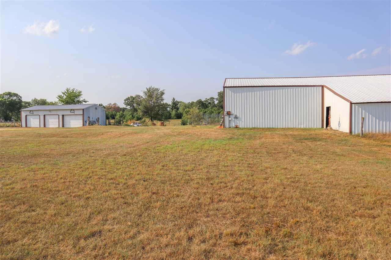Great rural horse/hobby farm property in a very desirable location.  Bring your animals and get ready to enjoy the 2 grazing fields with open face structures, the 9 stall horse barn with tact room, and the 15 acre crop field that is currently being rented by neighbor.  Plenty of room for your toys in the 3 car garage.