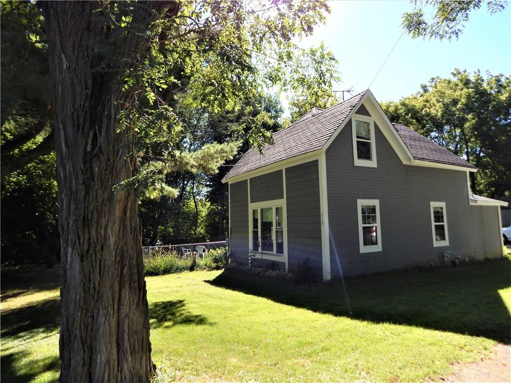 Country charm is what you will find in this 2 bedroom with new flooring all around! The property sits on the edge of town with the Gandy Dancer Trail in your backyard, great for snowmobiling or biking. Walk out the sliding glass door to fenced yard with apple trees! Large insulated detached 2 car garage with space to work in.
