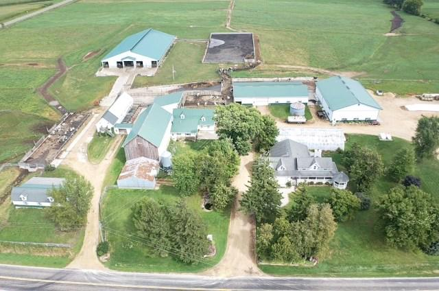 More than your average Dairy Farm! Currently milking 185 Holstein cows, with the potential & vision for expansion. Free-stall barn, manure pit, shop & commodity building were all new in 2016. Large cement/gravel feed pad area, 1.1 million gallon cement manure pit, calf & heifer facilities.  This dairy is set up with no detail missed. 75.22 acres total 42 acres currently used for rotational grazing, the balance work ground. The home has been completely remodeled to the fullest possibility with no corners cut. Other possibilities include a bed & breakfast, farm store, Ag Tourism attraction or ??? If you are looking to start dairying, upgrade your dairy operation or a place in the country to get-a-way from it all, this is the place you've been waiting for.  Additional 257+/- Acres available.