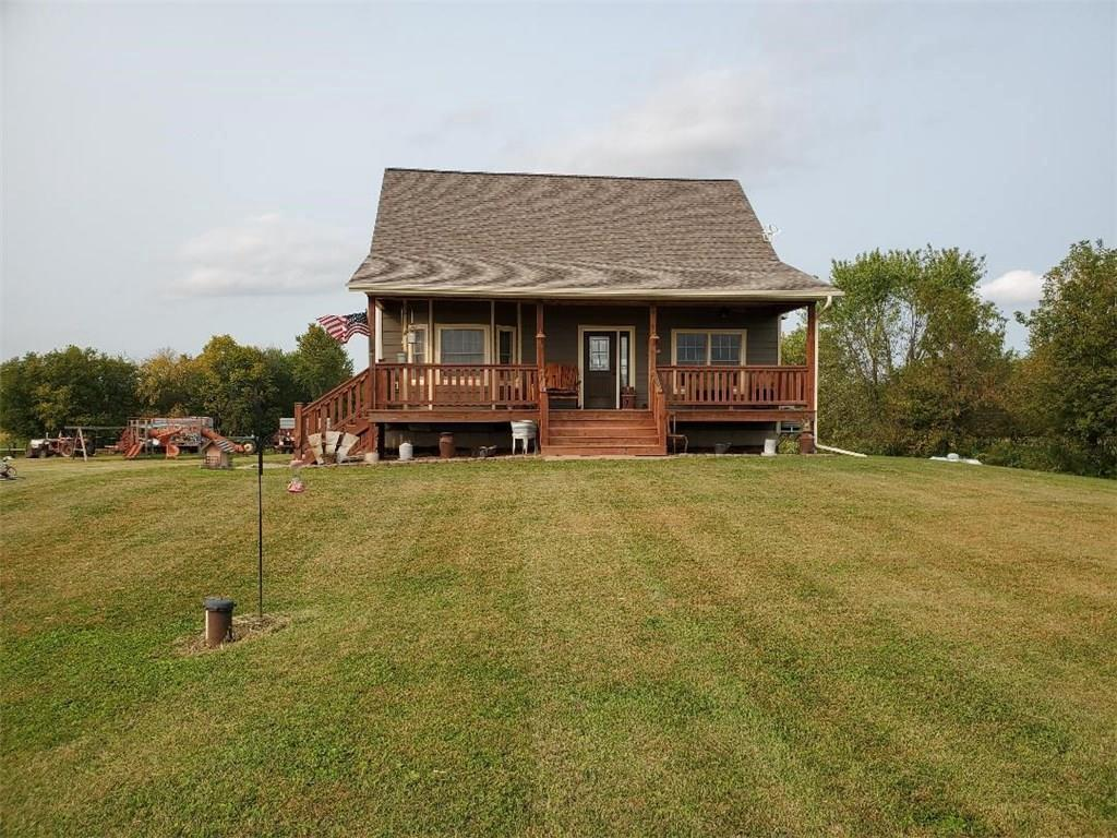 Quiet Country living just an hour drive from the Twin Cities. Large home, open concept on 5 Acres. Great place for a small hobby farm.