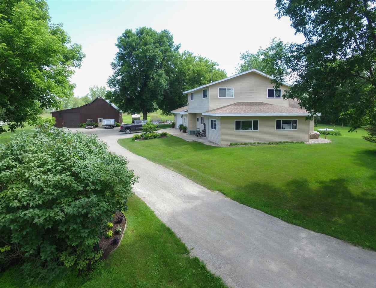 An outdoor enthusiasts, hobby farmer, and horse owners dream! A truly unique property of 7.41 acres surrounded by 434 acres of the Little Tail Unit which is part of the larger 9000 acre Green Bay West Shore Wildlife Area conservatory. Premier hunting, fishing, boating, kayaking, snowmobiling, and ice fishing right out your front door. This extremely private property on a dead end road includes a horse barn with stables and a large storage barn with hay mound. The two story, 2,256 sqft home with views of the Bay inside of Little Tail Point has 3 bedrooms, 1.5 baths, large vaulted living area, a