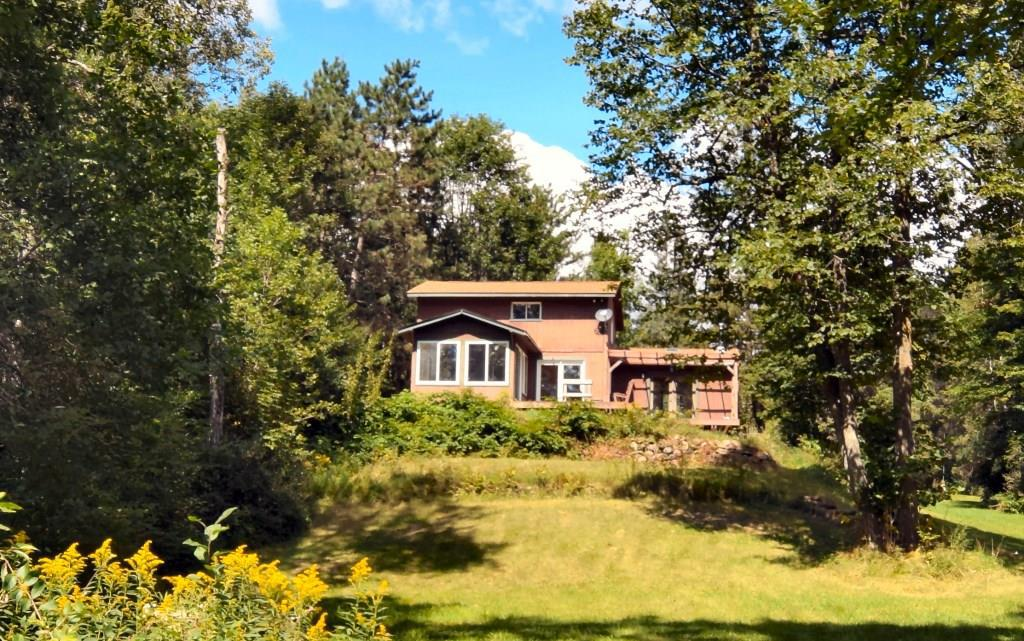 PRIVATE setting on the Chippewa River!  This solid chalet-style home is ready for someone to love.  Park-like yard w/gentle slope to level waterfront w/over 200' frontage. 2 detached garages; one heated/insulated. Home has bd, 2 baths & laundry on main level + 2 lofted rooms w/closets in hall.  Vaulted ceilings & 3 season rm overlooking river. Lot of potential to make into great yr-round river home-ready for new flooring & your own improvements.  Selling As-Is. See attachments for details.