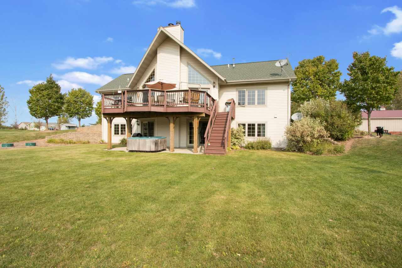 Beautiful Country home on 10 acres minutes from Green Bay/De Pere complete w/ 30x36 outbuilding & 14x24 shed. Features: Stunning views from Great rm w/ wide plank white oak floors & cathedral ceilings; Great rm also has cozy gas fireplace & 2 patio doors that lead to the large composite deck; Kitch w/ island seating, backsplash, pantry, and Industrial grade DCS appliances including sub-zero refrigerator & Kitchen-Aid Dishwasher; Large Fam rm in LL w/ wet bar & gas fireplace; Garden shed w/ Dog Kennel; water & electric in Horse barn w/ 4 stalls; Chicken coop w/ outside run.