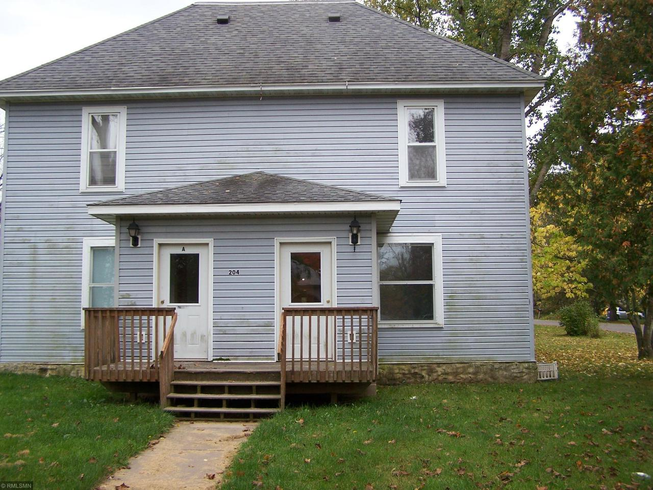 Great 4 bedroom, 2 bath and detached 2 car garage on a big lot in Milltown. House used to be a duplex and could be changed back into a duplex.