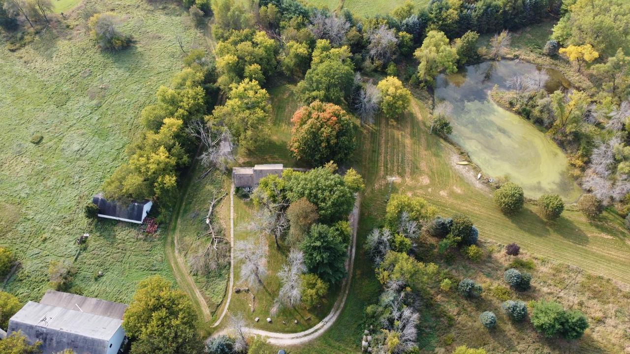 Secluded 120 acre farm in the heart of Erin, minutes from Holy Hill and Erin Hills Golf Course. Property consists of a mix of tillable organic farmland, prairies, ponds, hardwoods, and meandering streams complete with waterfall. 2 bedroom home with potential office in lower level. Concept map for rural cluster home development. Property includes solid well maintained 2 story year round log farm house and various out-buildings including barn. Must see to appreciate.