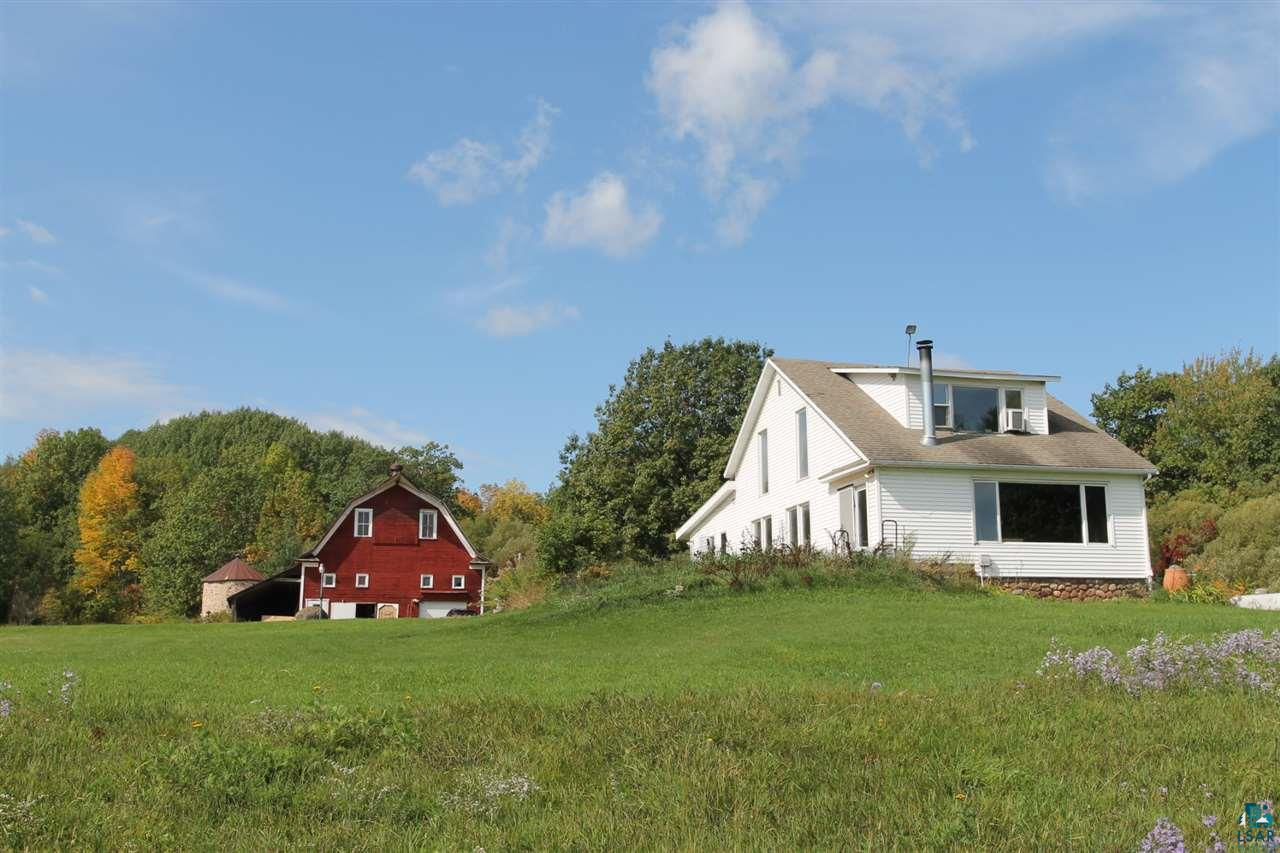 Truly a one of a kind property in Bayfield, WI. Turn of century farmhouse and barn. Approximately 25 acres with panoramic Lake Superior views. Original barn with Rock Silo and Apple orchard Home features 3 bedrooms, 1 1/2 baths. The opportunities for this property are endless.