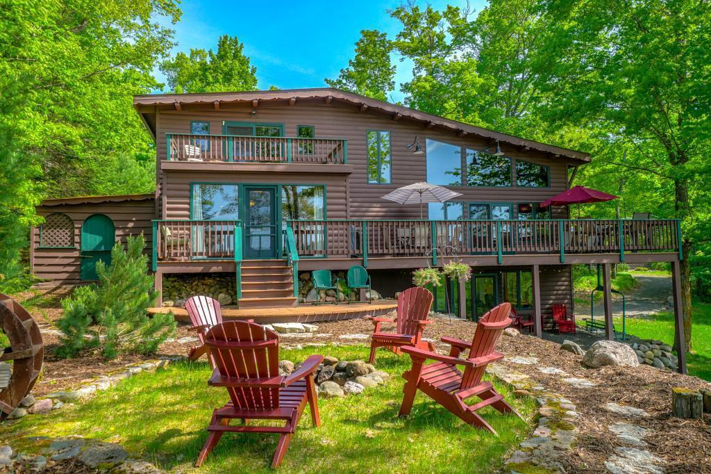 Welcome to Hemlock Lodge on Spider Lake! With 14+ acres and 865 feet of meandering shoreline, this gem gives you the wilderness feel and privacy you've been seeking. The 3 BR/3 Bath remodeled cabin has been well cared for and has a classic northwoods feel. Amenities include 18x25 screen porch, open concept kitchen/LR, lakeside den/dining room, main level laundry area, master suite with amazing views, 4 fireplaces, and a newly remodeled lower level. 40x60 pole barn with power/partial concrete floor. You'll love the 32x32 permanent dock platform for island & wildlife viewing as well as the floating dock and boat lift--both of which stay in year-round, saving you time & money. Many updates including all lakeside windows, updated electrical and lighting, exterior paint, and central A/C. Property abuts State owned lands. Spider Lake is a clear water, charming chain of 5 interconnected lakes. Water depth is approx 18 feet at end of dock, about 5 feet at end of lift. See the video for more!
