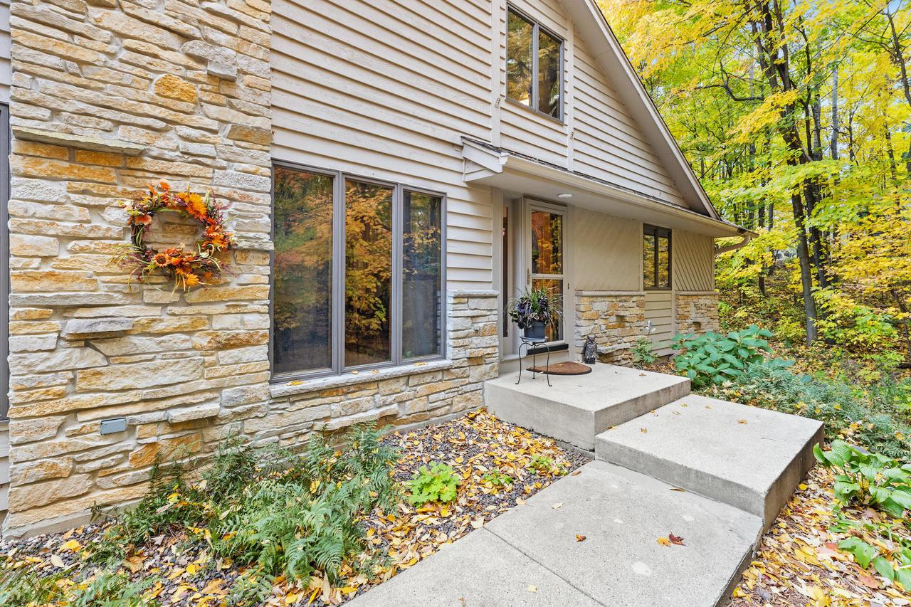 Privacy and nature abound in this lovely Slinger home (Slinger School District). Located on a desirable cul-de-sac, this spacious Cape Cod offers a convenient circle driveway, large cook's kitchen, formal dining room, 3 good-sized bedrooms, and 2 full bathrooms. Cool additional loft space for watching TV, working on your yoga pose, or make it your home office - Zoom away! Beautifully wooded 1.72 acre lot, along with a spacious deck to entertain, or unwind and relax. Finish off the large 11 course basement for additional rec room or work out space. Home has been meticulously maintained - just unpack and move in! Seller is providing 1 year UHP Home Warranty for your peace of mind. Call today for your showing!
