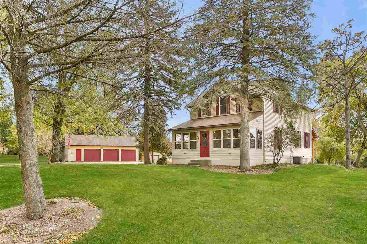The Farmette that you have been waiting for with 12.7 acres, approximately 325' of Yahara River Frontage and so close to the city of Stoughton. Enjoy long country views and abundant wildlife from your composite deck and charming screen house or linger in your large 3-season screen porch. Garden and bonfire pit, 3+ car garage, extra sheds and zoned for animals. Inside find big country kitchen, formal dining and living rooms, office, 1st floor laundry and three generous bedrooms upstairs. Also includes parcel number 0511-084-8400-7.