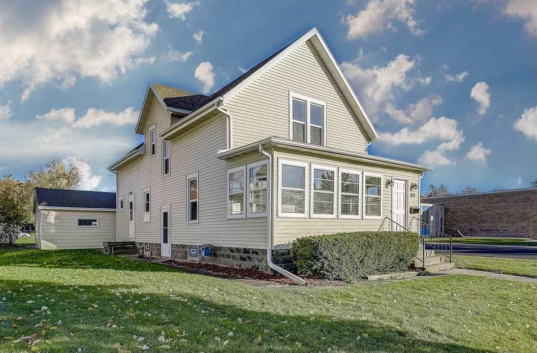 Old World craftsmanship juxtaposes seamlessly with New World composition, design and decor in this crowning Two-Story on Historic Watertown?s south side. Tonge and groove hardwood floors throughout - bountiful and pristine woodwork untouched by time, demonstrate skill from a by-gone era. Natural light floods a dynamic and sprawling floorplan through new windows - tile and dark wood ascent the baths. A bright, high energy kitchen boasts solid surface countertops - a red brick fireplace serves as the hearth of this home. Upstairs, a massive Master Bedroom offers a walk-in closet and Victorian sitting room. New roof, new furnace, new water heater. Modestly priced for expeditious sale.