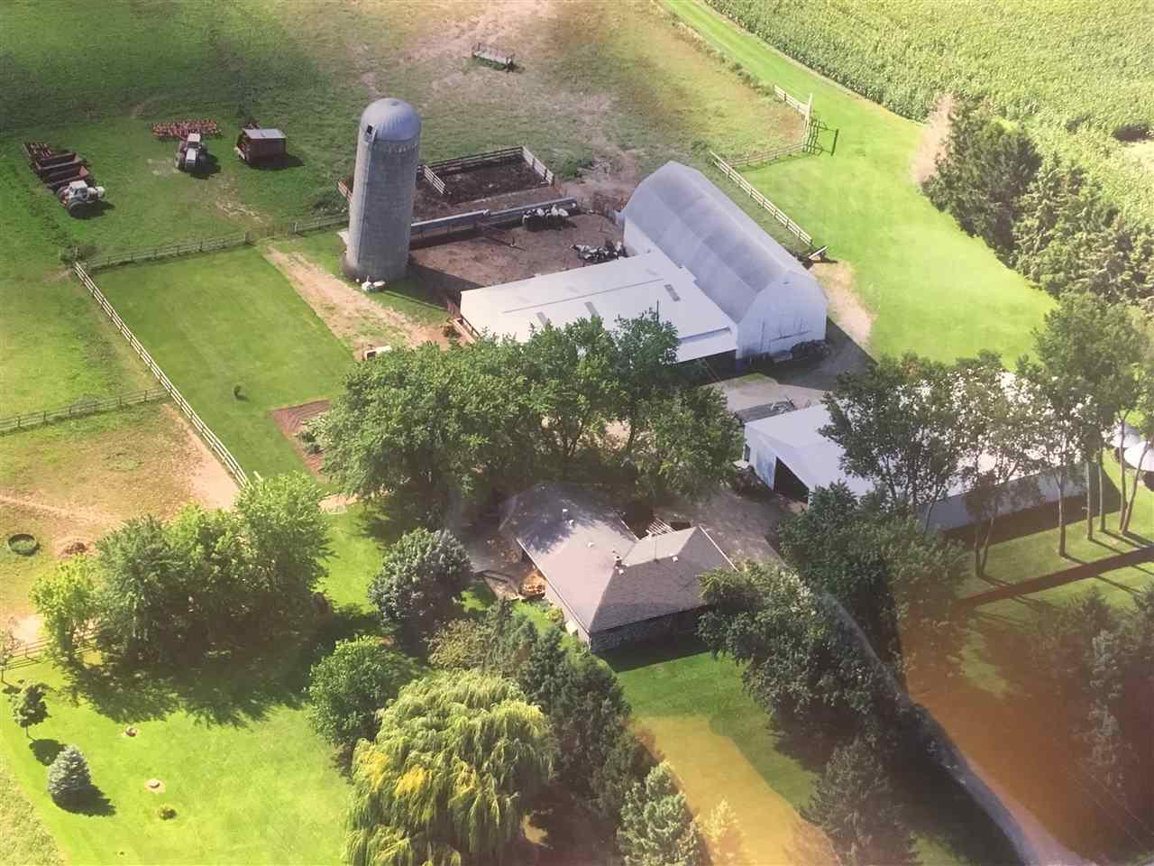 A rare find, a turn key apr. 8 acre farmette with a 36x76' barn, a 50x70' addition, a 55x90' pole building. Currently set for beef and horses but could easily be converted. Also a beautifully redone 3 bdrm ranch house with a lower level Family room plus a first floor breezeway with a pellet fireplace insert. The furnace is a dual heat source that heats with wood as well as fuel oil and will shift automatically if it runs out of wood. Add a wrap-around deck with a panoramic view plus a fenced in riding area and you will soon fall in love with your very own piece of paradise.
