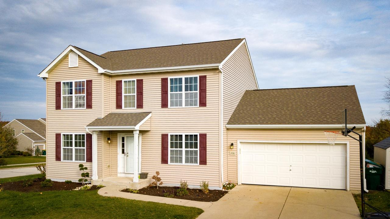 Enjoy beautiful views from a quiet subdivision with this 4 bedroom, 3 1/2 bath home. Highlights include new flooring throughout main level and walk-in closets in all bedrooms. Mud room has laundry hooks ups if 1st floor laundry is desired. Open concept kitchen/living room is great for entertaining. Upstairs offers two bedrooms that share a full bath & spacious master bedroom overlooking fields and woods. Walk thru master bath opens up to huge master closet. Partially finished basement offers family room, 4th bedroom, laundry room & yet another full bathroom. The tasteful updates with this location makes for a combination you will not want to pass up on.