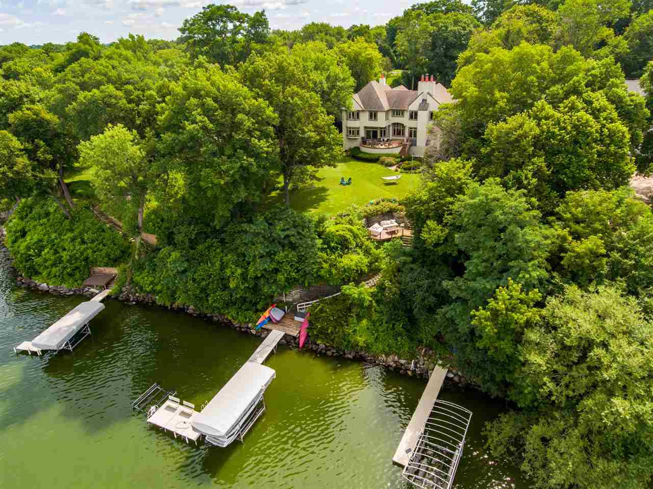 Lakefront living. Incomparable style. Breathtaking views of Lake Mendota w/100' of frontage. Ideal for ?statement? hosting - open, versatile, & unique. Bright kitchen for the gourmet w/premium appliances, dbl ovens, island w/prep sink, etc.Lush yard & large west-facing deck are made for serene sunsets. Upstairs features 4 bdrms, including sumptuous master suite w/dual walk-in closets. Walk-out LL is a playground w/billiards, wine cellar, bar, FP, sauna, exercise rm, & huge family room for game-night or gameday. Au-pair-style apartment (bath, kitch?et, semi-priv entry) provides options for family, friends, & live-in help. Priceless location right across the street from award-winning MBCC golf course's hole #13. Welcome to this sought-after Village - where you'll love staying at home!