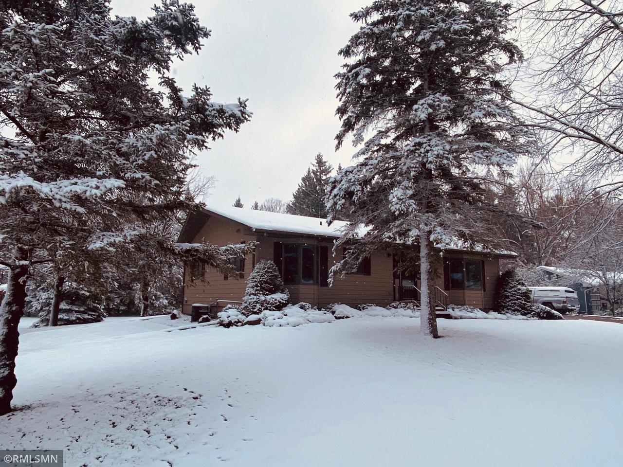 Many great updates on this in town rambler on nearly an acre! Garage is insulated/heated and nicely finished. Main floor laundry, large spacious rooms. New in the last 4 years: furnace/ac, water heater, carpet, tiled shower, wet bar, paint, basement sealed up and completed. Note basement bedroom does not have egress. Lots of house and outdoor space!!