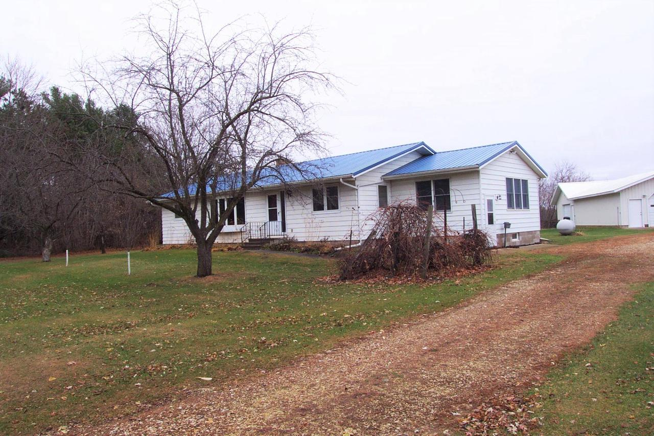 46.36 acre Ranchette with 16 organic tillable acres.  Country life with city amenities; water & sewer, fiber-optic cable for internet, phone and TV. 20 mins from freeway, 30 mins from Eau Claire. Walking distance to the Red Cedar trail, boat landing, a walking trail for walking, biking & cross country skiing. This property also provides several personal/business opportunities, i.e. organic hobby farm, organic business, rental property, wedding venue, etc. All buildings are in great condition! Buildings include: Barn 34x60, Pole Building 30x60+18x30. This parcel has Two homes multi-generations and both are move in ready! 2nd Home is one story w/1207 S.F. full basement w/LP forced air heat & central air. Home has main floor laundry, 1.5 baths, 2 bedrooms, stone & cement block basement. Steel roof & siding. Located at N2486 County Road C, Menomonie.  Land is located between Hwy 25 & Cty Rd C.  Come take a look, Pictures doesn?t show it all!