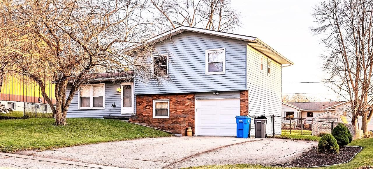 This open concept, main level offers family room, dining room and living room with new floors and floor board heaters. Sliding door to your backyard patio welcomes you to your oasis.  12x10 storage shed in back yard for your convenience. Garage door opener is new, and extra special as it offers a quiet close and open. Front yard newly landscaped for a clean slate to welcome new owners ideas. Lower level den is perfect for home office. 3 bedrooms located on the upper level. Master bedroom offers full bath with stand-up shower.