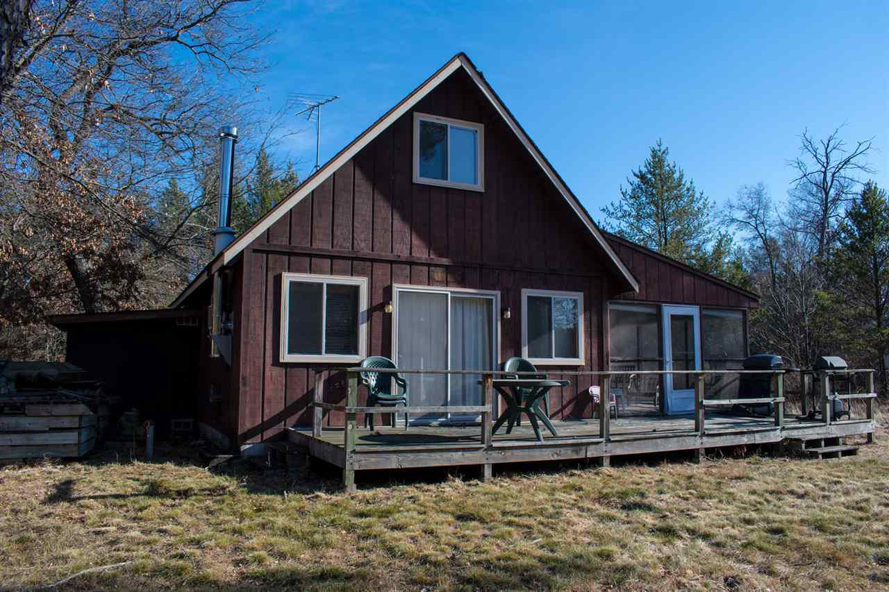 """Cute and affordable """"cabin"""" in the woods. Offering 2 bedrooms, 1 bath and approx 1000 square feet of living area. Being sold mostly furnished, it has a free standing wood stove for those cool nights, a screen porch, storage shed, all on a .5 wooded lot. Within walking distance of Castle Rock Lake. Move in Ready!"""