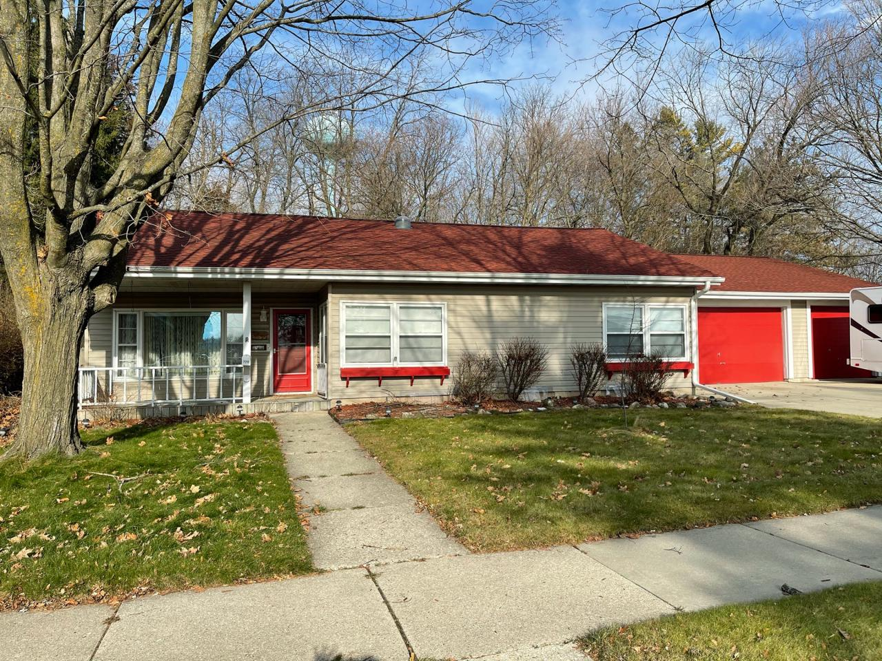 Ranch home with huge attached garage and sunroom with beautiful back yard. Home features large living room with a gas fireplace, 3 bedrooms and room to work, play and live!
