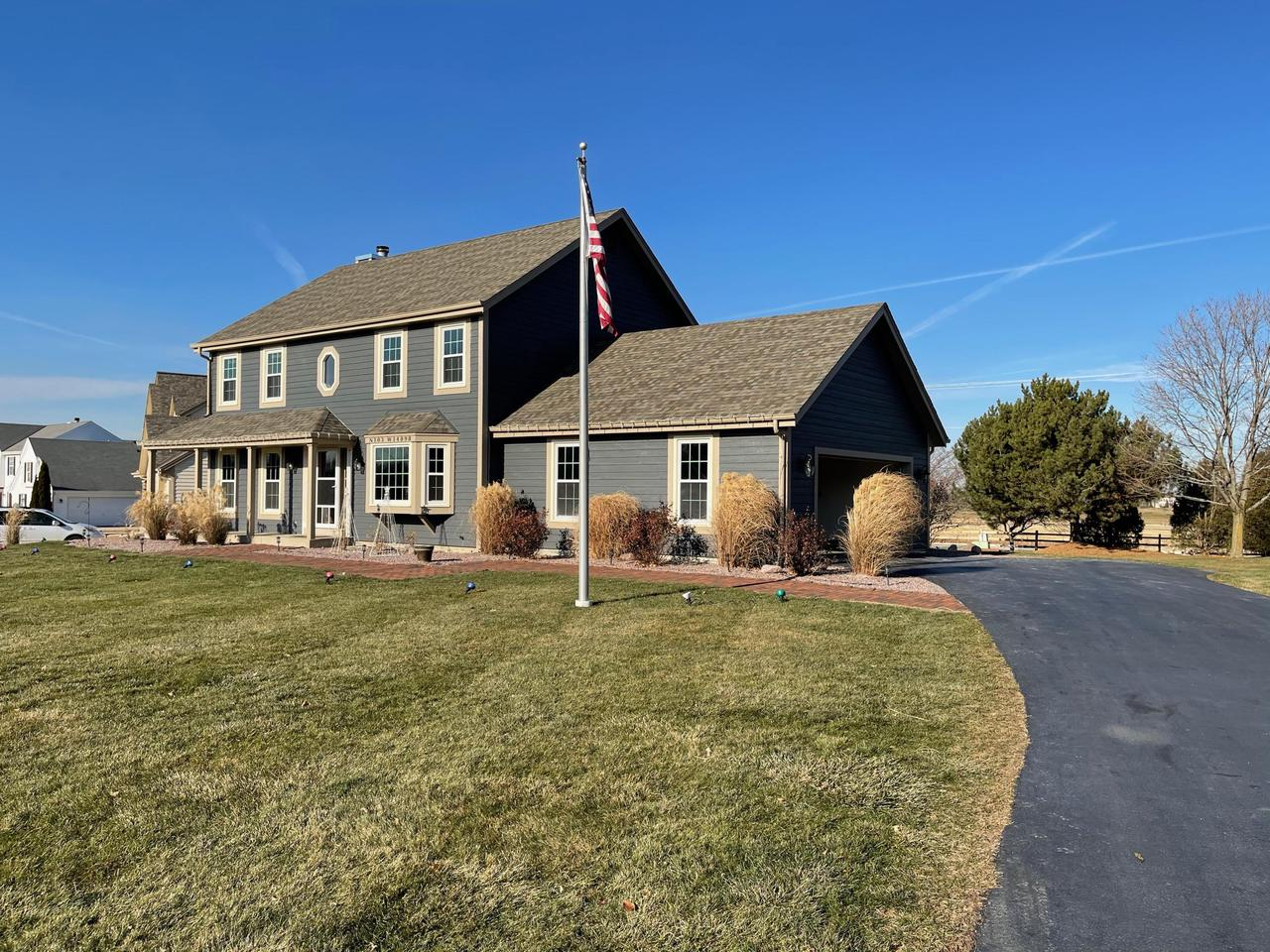 Quality built 4 bedroom, 2.5 bath home in desirable Windsong neighborhood, with acres of common green-space, walking trails, ponds and play space. Situated on just under 1/2 acre, this charming colonial offers many recent updates including all new LP Smartsiding, all new windows, new roof in 2015 and lots of new landscaping! Main level features a formal dining room, office/den or playroom, large living room has a gas fireplace with custom stone surround and a great kitchen with dinette and patio doors leading to an expansive patio and beautiful backyard. Upper level offers all four spacious bedrooms, master has a nice walk-in closet and spa bath. Lower level prime for finishing to add another bath plus a rec room and/or gym area. Finished 2.5 car attached garage.