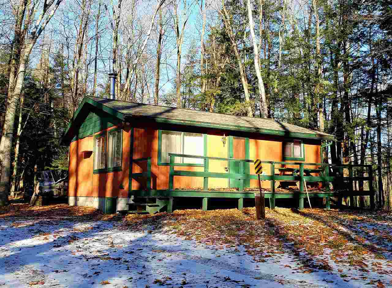 This 2 bed, 1 bath open concept cabin sits on a fully wooded lot surrounded by rolling hills in close proximity to East Horsehead, Ava and Long Lake just outside of Rhinelander. The property includes shared interest in outlot with water frontage on East Horsehead Lake. 4 season cabin with conventional septic, drilled well, baseboard heat, wall A/C, new 2020 roof and water heater.  This place would be the perfect hunting or snowmobile camp!!! Bearskin Trail system and public hunting close to cabin.  Being sold AS-IS at phenomenal price for super quick sale. Furnishings negotiable.