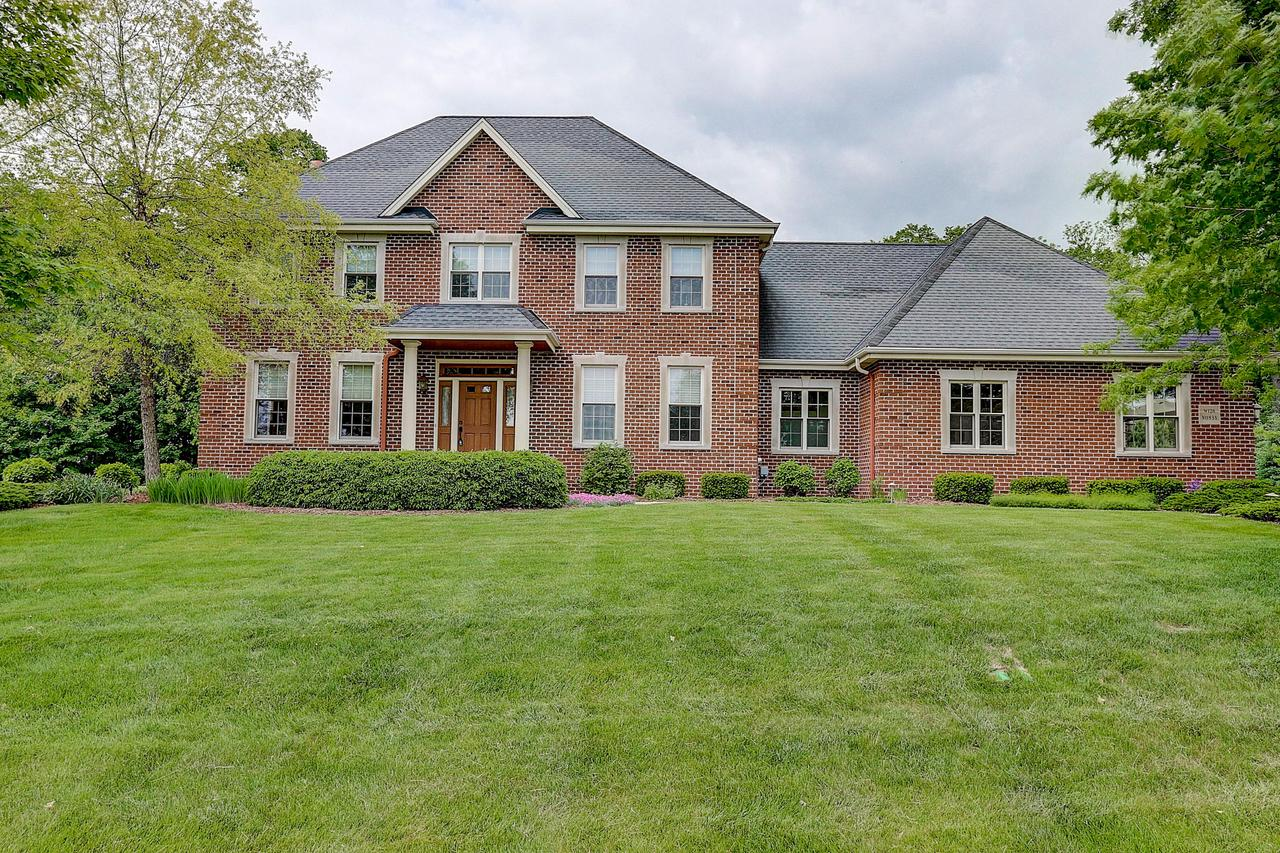 Custom  brick home on a 2+ acre lot. Beat the crazy low inventory early spring rush and the competition from other buyers. Remember last years craziness. Mahogany floors, birch crown molding & cabinets. A gourmet kitchen with large island, pantry, & a dining area that opens up to a spacious family room with a beautiful gas fireplace. Relax in the cozy sunroom with vaulted birch ceiling. Large master suite with walk-in shower, tub, and HUGE 11X16 closet. Bedrooms are spacious and bright, two with walk-in closets and built-in desks.  LL rec room with wet bar & 400 bottle capacity wine room. Take in the beauty of the woods from  the patio, perfect for dining & cozy fires. Plenty of storage in the 3+ car garage with  stairs to the bsmnt . See seller updates under ''Documents '' for more info