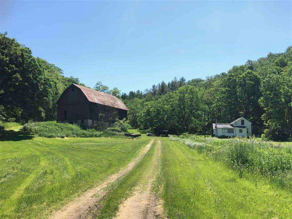 "Amazing Recreational Retreat!!  Offers hunting, fishing, hiking, snowmobiling, atv riding and farming opportunities.  This property has a class II trout stream, West Branch Blue Mound Creek, running thru it.  It has 169 acre wildlife sanctuary that borders thousands of acres of practicing Quality Deer Management land.  The property sets up well for making it your own trophy whitetail property.  Plenty of trails and areas that setup well for food plots as well as 58 tillable acres that can be rented or enroll in  the CRP program.  It is home to trout, whitetail deer, rabbits, turkeys, squirrels and many other wildlife.  Rock outcroppings and beautiful western views of the sunset.  There is a small home and a Barn on the property that are being  sold ""AS IS""."