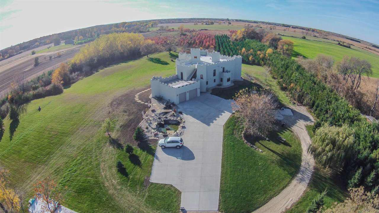 *Airbnb or Wedding Venue potential. Modern, open concept, custom built castle on 25 acres of prime ag. Walk in rain shower on main level. Full master suite with walk in closets, adjoining master bath, with walk in shower and his & her vanity. Private plant life patio off of your office or reading room. Entertain your guests on your walk out roof patio, overlooking gorgeous views. Gourmet kitchen, dry bar, DR, LR & foyer all have 17' + high ceilings. Hurricane proof windows & doors for storms & safety. Plenty of wildlife, pond with waterfall  & mini stream. Everything was thought of to prep for your future additions. Secret rooms, tunnels and passages in your lower 4000+ sq ft. Preppers, investors, and dreamers will not want to miss this opportunity.