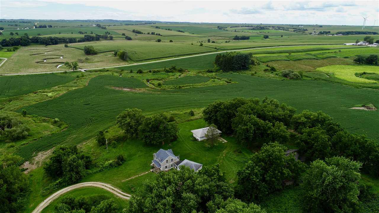 Seymour township Tama soil farm for sale! 98 tillable acres leased through 2020 for $275 per acre. There are currently 2 homes on this property. The smaller second home has 2 bedrooms and is approximately 1,144 sq. ft. Both homes require significant updating (visible mold).  But this farm has a well and septic, mature trees, and Ames Branch creek runs through the property. This could be a magnificent place to build your dream home. Measurements and square footage are approximate. Buyer to verify if important.