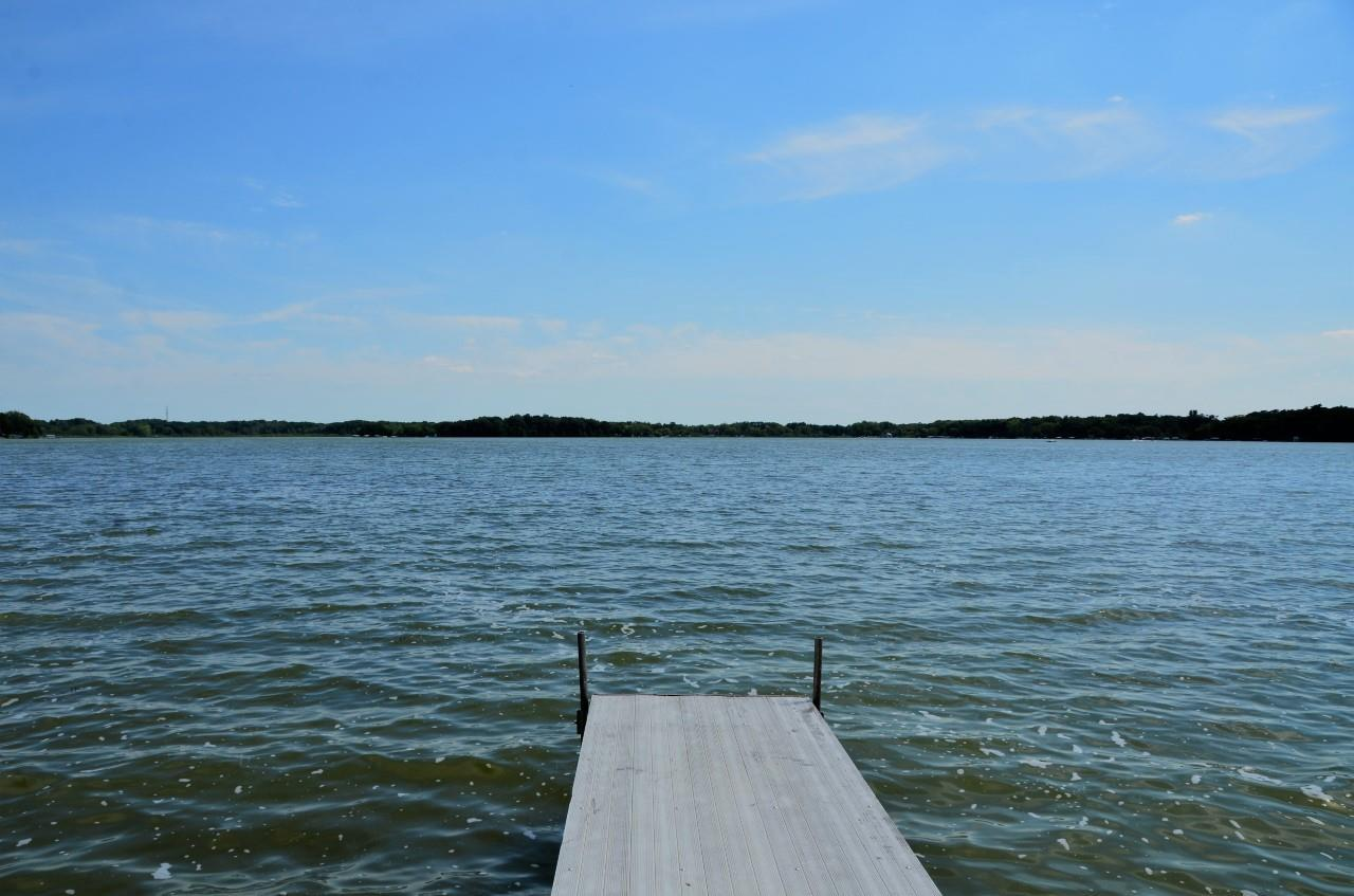 Welcome to Lake Ripley! Year round home or your very own retreat! Beautiful views of Lake Ripley, 105' of shared lake frontage, piers, and boat slip area awaits.  Imagine sipping coffee from your 4 season porch or deck enjoying the sun dancing across the water. Plenty of memory making moments are sure to please! Solid built home overlooking Lake Ripley has eat-in kitchen with room to expand your table and serve a crowd! Family room spans length of home offering wood burning fireplace for those cozy Wisconsin winters with a large picture window to frame your views. Spacious master with sitting areas greet you as the lake life day comes to a close. This lovely property boasts plenty of green space, sheds, and storage for all your toys plus a 524sqft 2+ car garage! It is all this and more!
