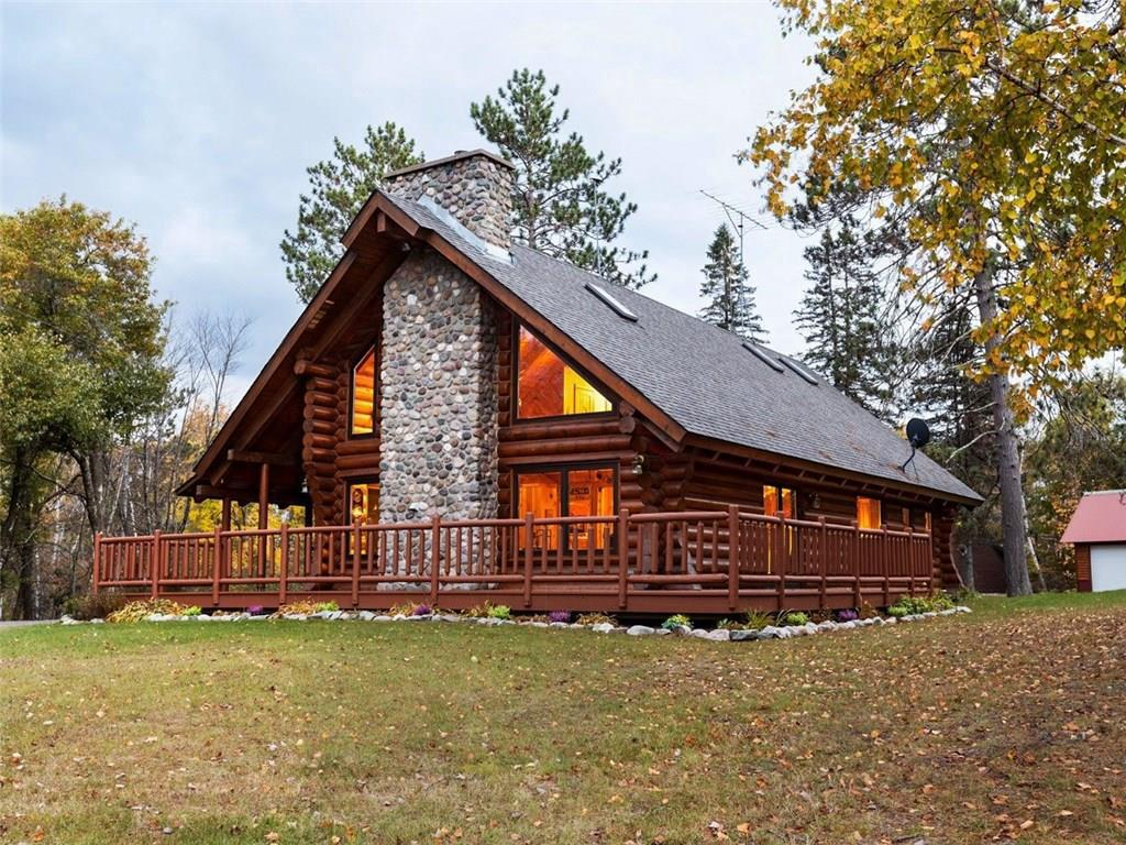 Stunning Montana log home in the middle of a 300-acre Northwoods retreat with private 80-acre lake. Beautiful split stone floor to ceiling fire place, half log stair case and tall vaulted ceilings really make a statement when you walk through the door. Views of the lake from most of the rooms in the home will take your breath away. The wrap around porch that is partially covered provides space to entertain friends and family and allows for a no step entry. The master bedroom has a huge walk-in closet, adjacent spa tub bathroom, views of the lake and a deck allow you to enjoy the morning with coffee. The grounds are well equipped with a small storage shed that could easily be converted to a bunk house, heated detached garage with work shop, large vintage barn and four stall cold storage building for all the equipment and toys. As you move about the property on the many well-groomed trails you will get a sense of total isolation as you are surrounded by wilderness.