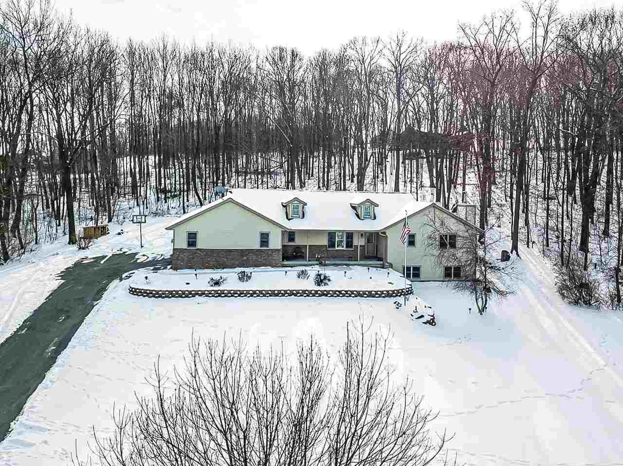 Welcome Home to this spacious, open-concept ranch home on 1.5 acres with Deeded access to the Wisconsin River!! Kitchen with in-lay tile floors, Corain ctrs, pantry and Huge island open up to huge Great Rm with vaulted ceilings, gas fireplace. 1st flr Laundry/mudrm out to 3 car garage w/ stairs to basement!!  Primary bedrm w/private bath & WIC!  LL has 4th&5th bedrms, FamRm w/ wood burning stove, wet bar & full bath!  Outside deck updated to trex decking, Retaining wall in front just re-done and driveway sealed. Roof and siding new in 2019!!  See assoc docs for more info!!  Call now!!
