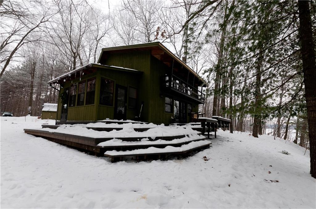 Looking for the perfect getaway or home? This cozy home or cabin sits on 1.84 acres on a dead end road with a long winding driveway. Property has 126 ft of frontage on Lake Thirty and is close to the boat landing. Located within miles to snowmobile and atv trails, and thousands of acres of county hunting land. This property won?t disappoint you with an open concept with large windows facing the lake, wood burning fireplace, wood floors, wrap around deck with plenty of space for entertaining, 3 season room and has a 2 car detached garage along with a bunkhouse for additional space for family or friends to stay. Some recent updates include new roof on home/cabin, added laundry area and new flooring in 3 season room. Sellers are willing to sell a 1991 Bayliner boat with a 70 HP Horse with trailer for $2000.