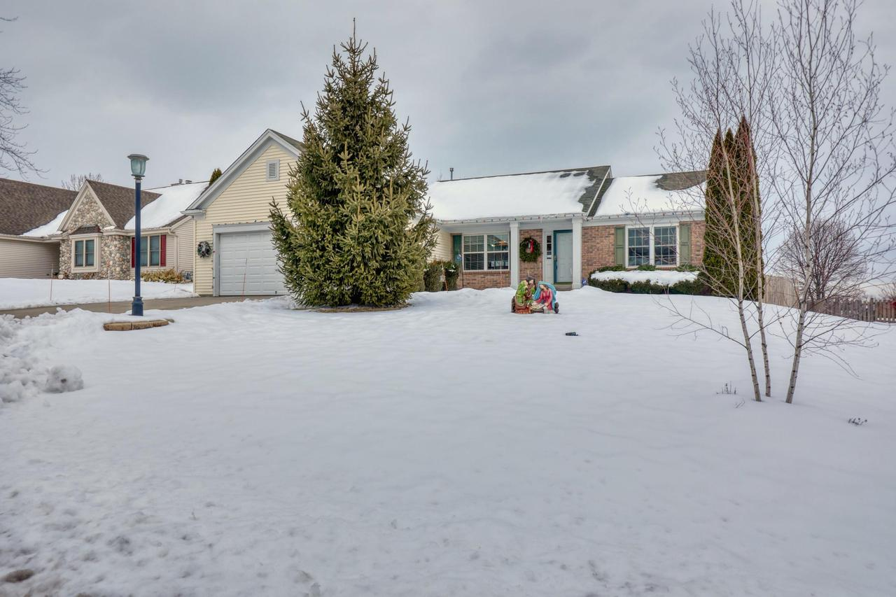 Beautiful Germantown Open Concept Ranch! You will enjoy the elevated views from your backyard deck. Master suite with whirlpool tub and walk in closet. Large kitchen space with breakfast counter bar and built in island. Convenient 1st floor laundry. Gorgeous stone gas fireplace. Huge finished lower level with bonus 4th room! This is it, come see it asap!